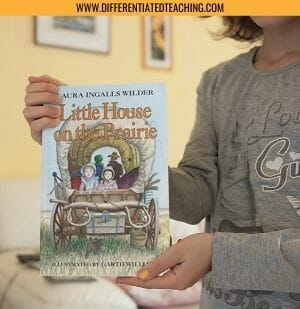 Child holding Little House on the Prairie